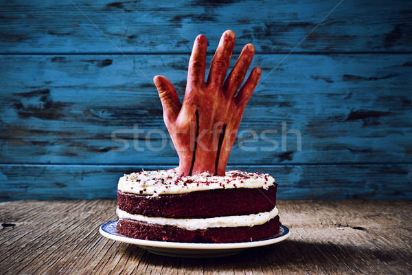 cake topped with a bloody hand for halloween Stock photo © nito