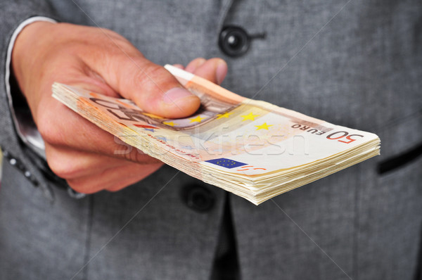 man in suit with a wad of euro bills Stock photo © nito