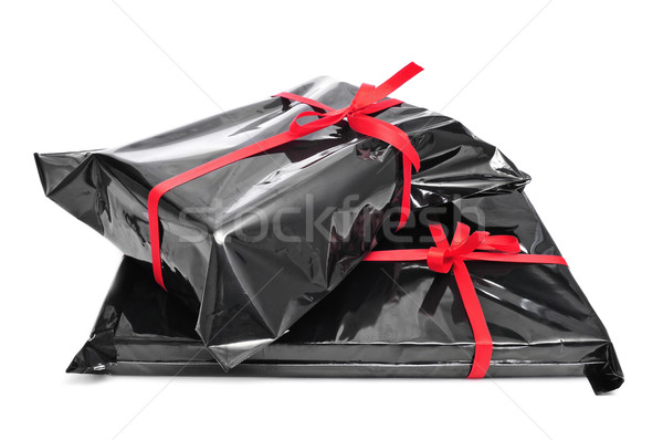 Ajándékok köteg fekete műanyag piros szalagok Stock fotó © nito