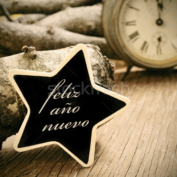 feliz ano nuevo, happy new year in spanish, in a star-shaped cha Stock photo © nito