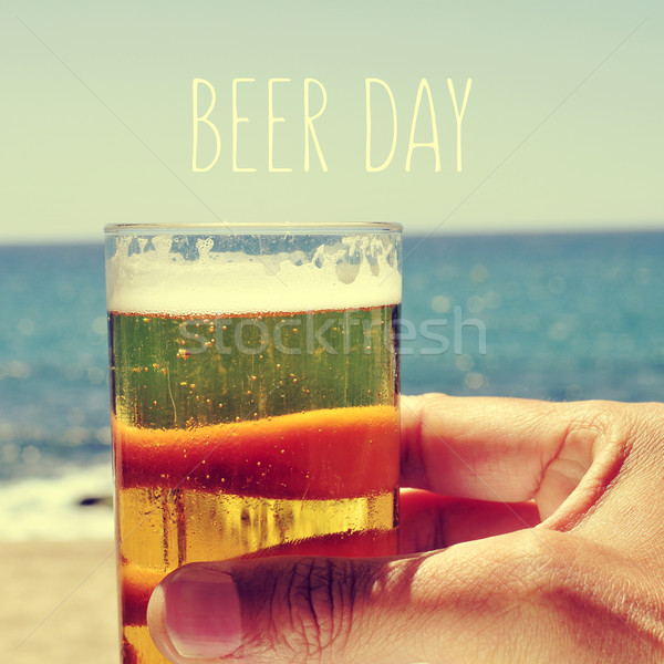 man with a beer and the text beer day Stock photo © nito