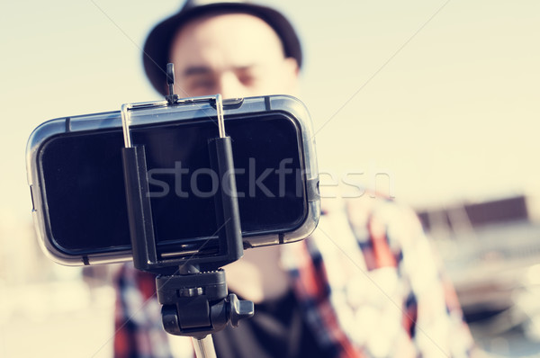 young man taking a selfie with a monopod Stock photo © nito