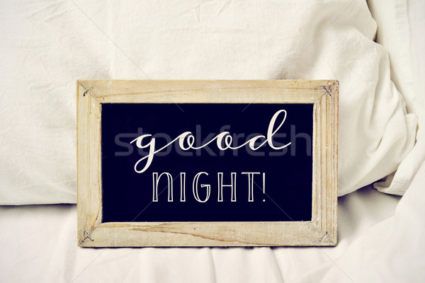 text good night in a chalkboard on a bed Stock photo © nito