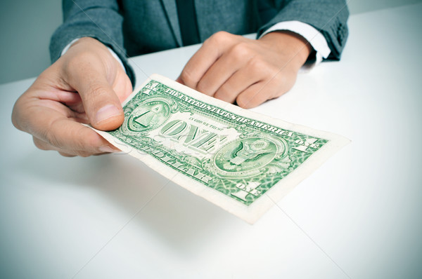 man in suit offering a one US dollar bill Stock photo © nito