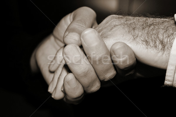 young man holding the hand of an old man, in black and white Stock photo © nito