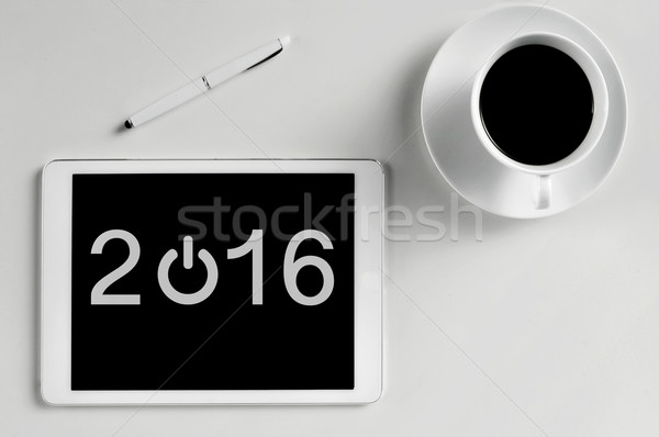 number 2016, as the new year, in a tablet computer Stock photo © nito