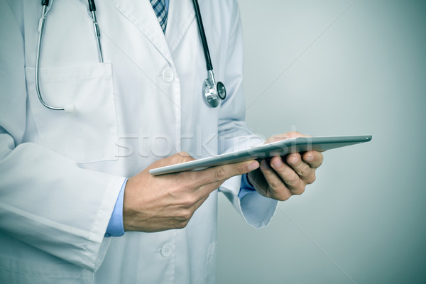 doctor man using a tablet computer Stock photo © nito