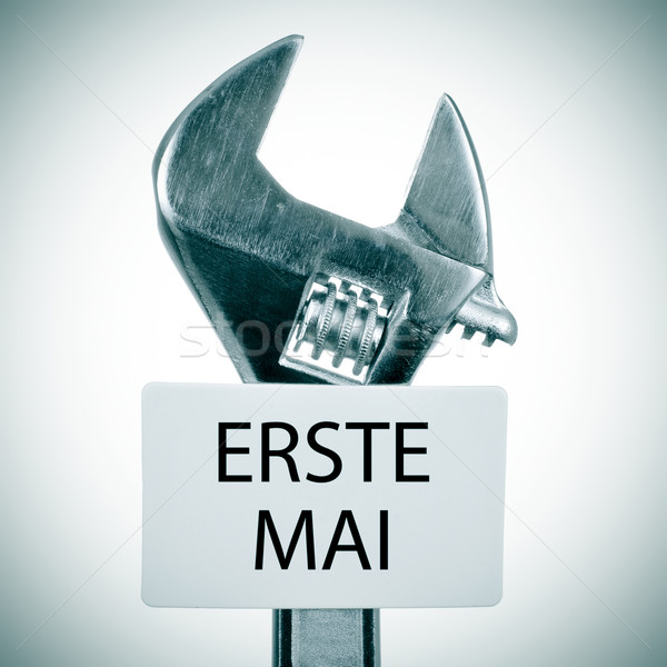adjustable wrench and signboard with text erste mai, may day in  Stock photo © nito