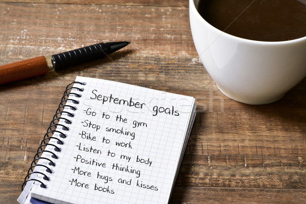 coffee and notepad with a list of September goals Stock photo © nito