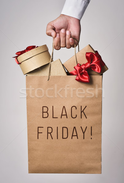Stock photo: shopping bag full of gifts and text black friday