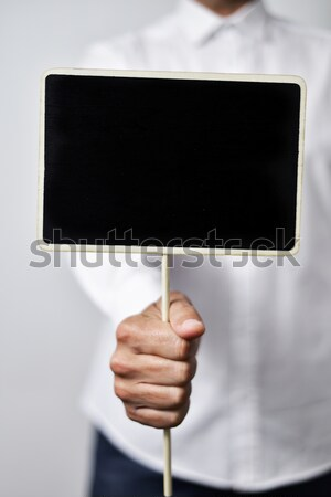 young man with a blank black signboard Stock photo © nito