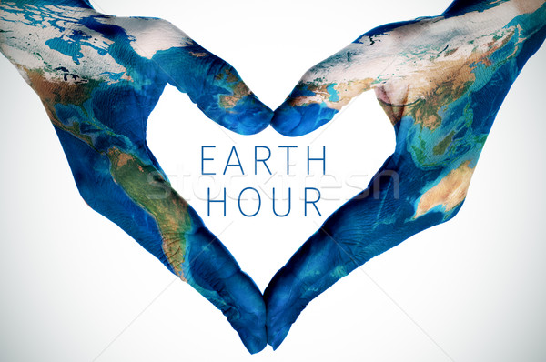 text earth hour and woman hands patterned with world map (furnis Stock photo © nito