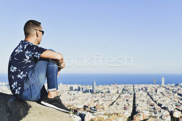 young man with Barcelona, Spain, below him Stock photo © nito