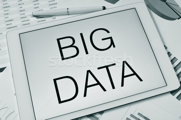 text big data in the screen of a tablet Stock photo © nito