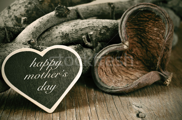 happy mothers day in a heart-shaped chalkboard on a rustic backg Stock photo © nito