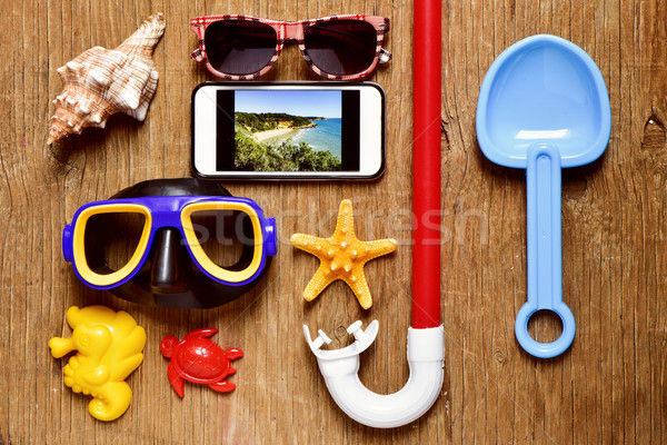 smartphone and some summer stuff on a rustic wooden table Stock photo © nito