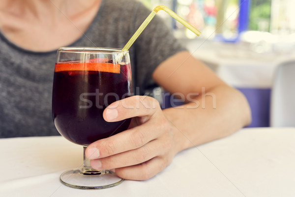young man with a glass of spanish sangria Stock photo © nito