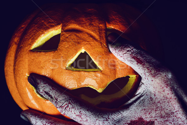 zombie or monster and carved pumpkin Stock photo © nito