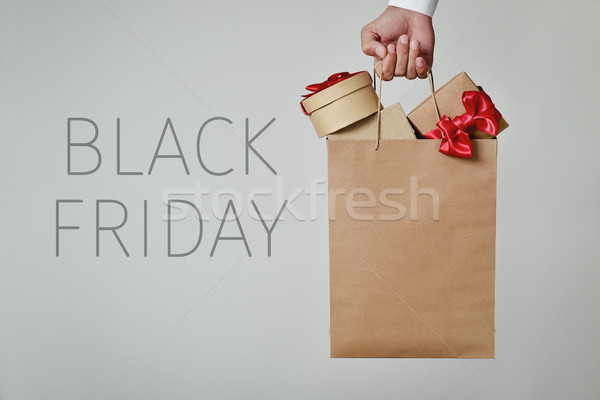 shopping bag full of gifts and text black friday Stock photo © nito