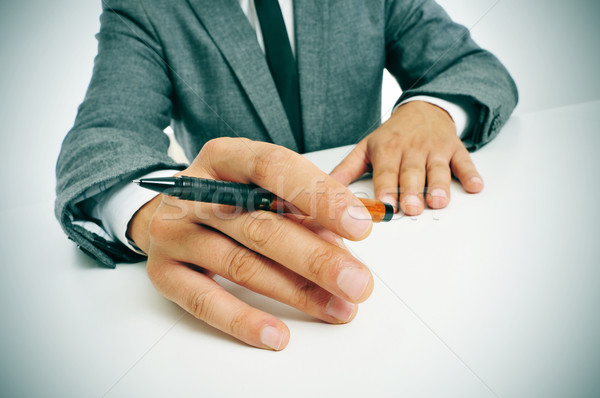 man in suit with a pen in his hand Stock photo © nito