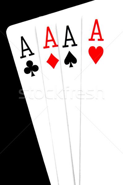 Quatre main poker noir fond Photo stock © nito