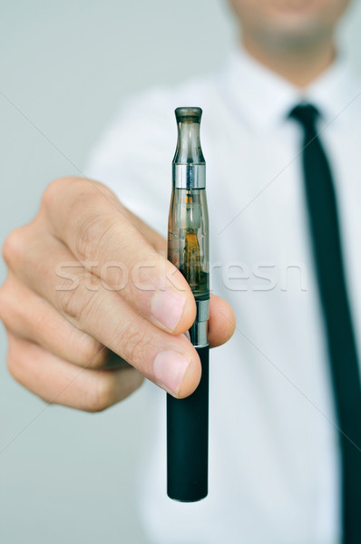 young man showing an electronic cigarette Stock photo © nito