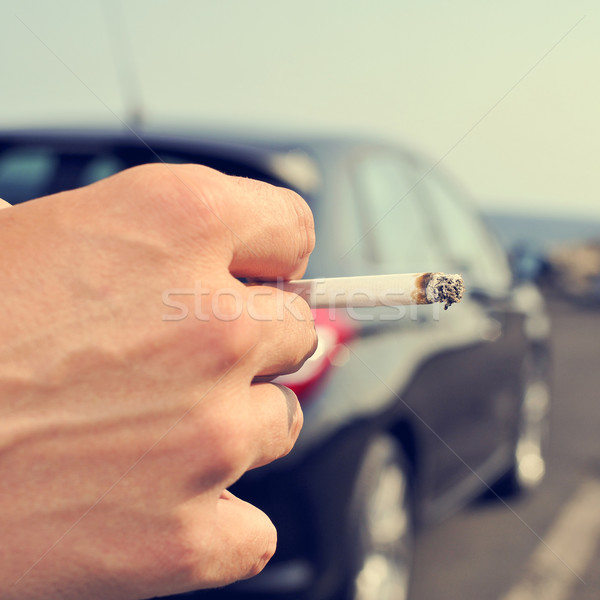man smoking in a no traffic road Stock photo © nito