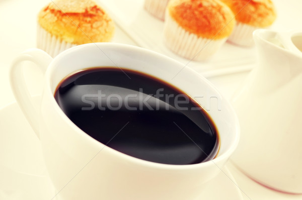 coffee and magdalenas, typical spanish plain muffins, filtered Stock photo © nito