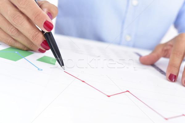 businesswoman with a chart with a downward trend Stock photo © nito