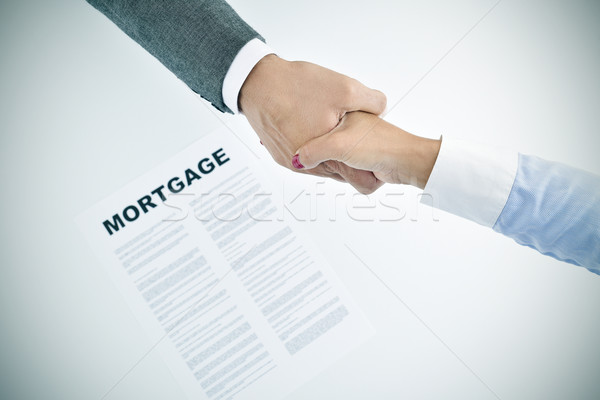 mortgage loan and man and woman shaking hands, vignetted Stock photo © nito