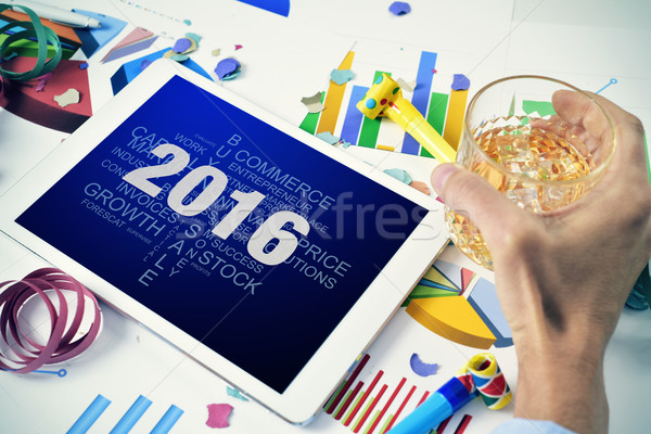 Stock photo: businessman with a tag cloud of goals for the 2016