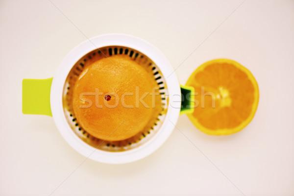 squeezing an orange Stock photo © nito
