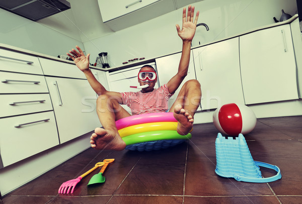 man swimming in an inflatable water pool, indoors Stock photo © nito