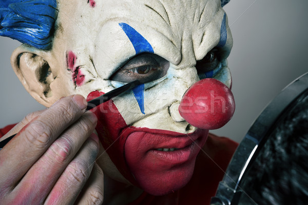 young man making up himself as an evil clown Stock photo © nito