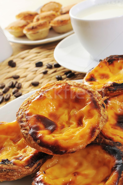 pasteis de nata and pasteis de feijao, typical Portuguese pastri Stock photo © nito