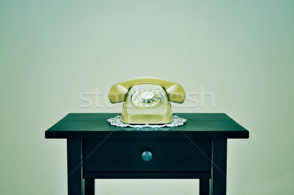 old rotary dial telephone on a table, with a retro effect Stock photo © nito