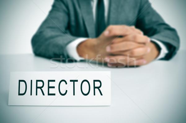 Direttore uomo suit seduta desk parola Foto d'archivio © nito