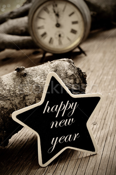 happy new year written in a star-shaped chalkboard, in sepia ton Stock photo © nito
