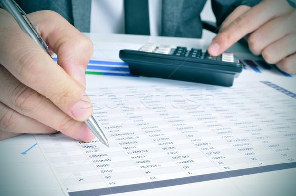Fiatal üzletember közelkép számológép iroda igazgató Stock fotó © nito