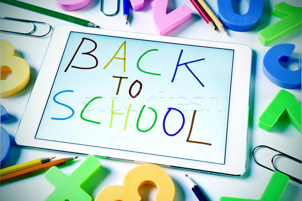 sentence back to school handwritten in a tablet, slight vignette Stock photo © nito
