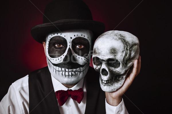 man with mexican calaveras makeup and skull Stock photo © nito