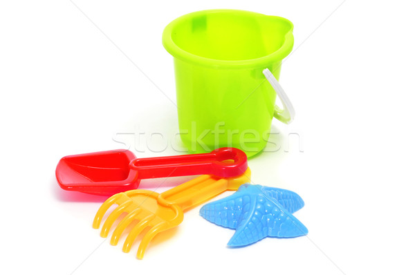 sand / beach toy set: pail, shovel, rake and star-shaped mold Stock photo © nito