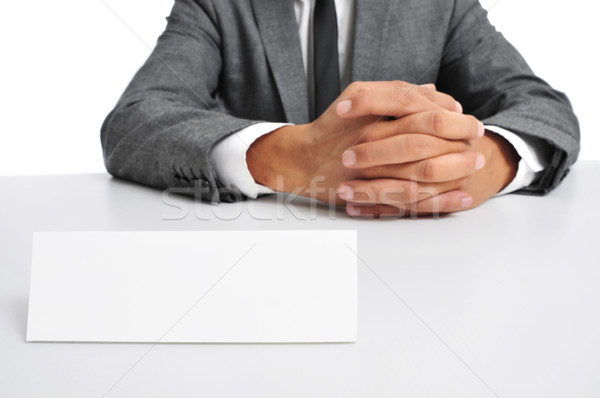 man in suit sitting in a desk with a blank signboard in front of Stock photo © nito