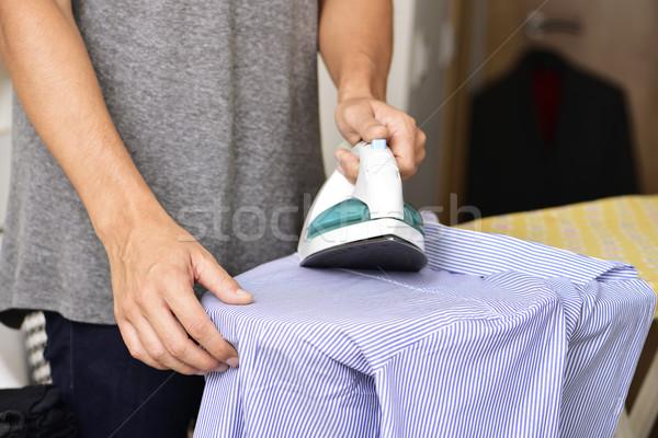 young man ironing a shirt Stock photo © nito
