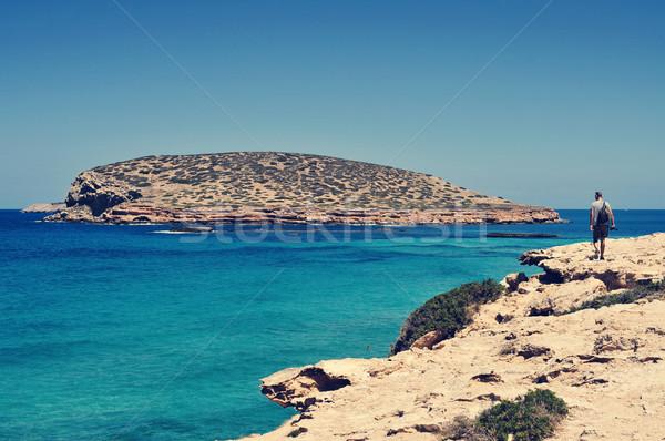 man facing the Illa des Bosc island, in Ibiza, Spain Stock photo © nito