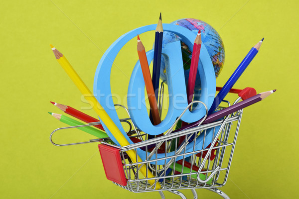 globe, colored pencils and at sign in a shopping cart Stock photo © nito