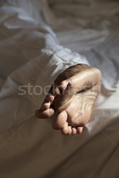 Młody człowiek bed stóp bose stopy Zdjęcia stock © nito