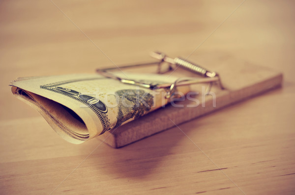 dollar bills in a mousetrap with a retro effect Stock photo © nito