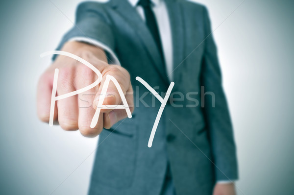 man pointing the finger to the word pay Stock photo © nito