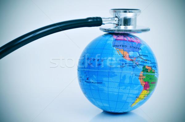 stethoscope on a terrestrial globe Stock photo © nito